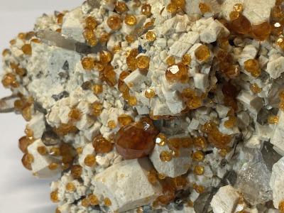 Spessartine with quartz on microkline